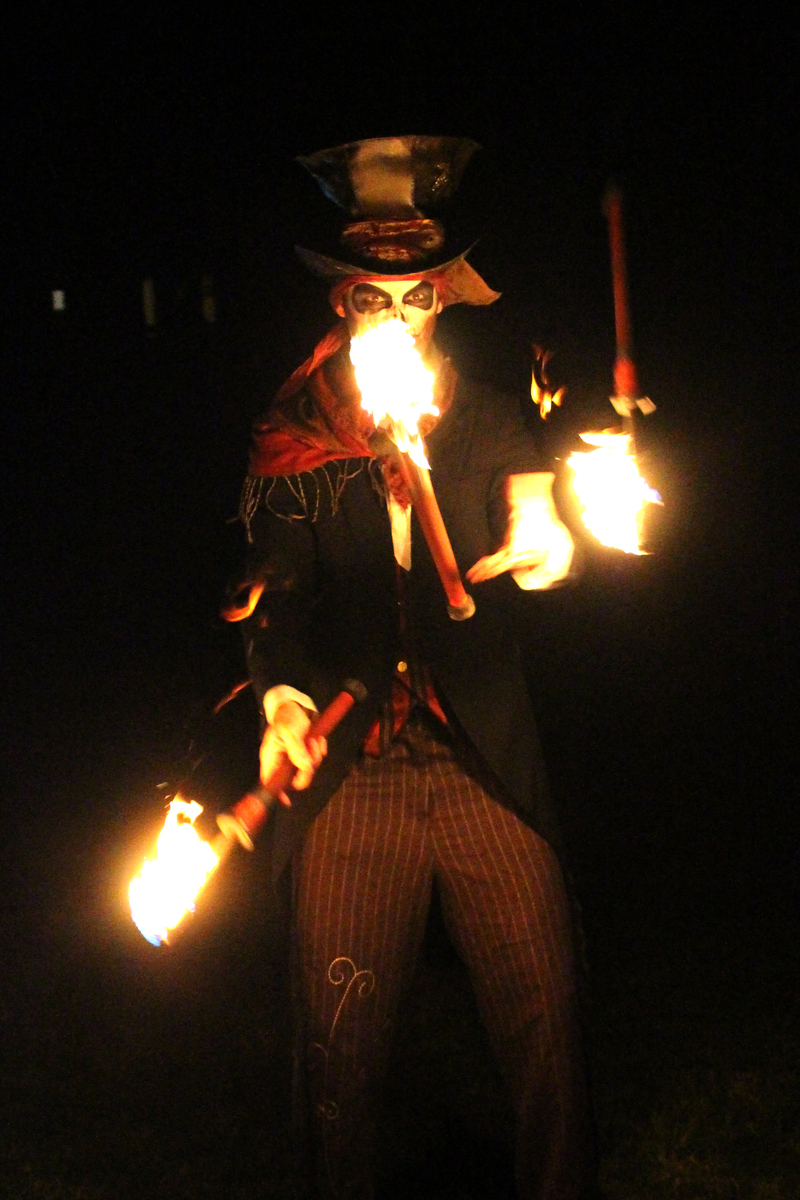 Fire Entertainer, Fire Entertainment, Fire Side Shows and Fire Jugglers and Fire Spinners from The Joker Entertainment at Public Events and Weddings, great for Christmas entertainment, bonfire night entertainment and Halloween entertainment in the Midlands, Nottinghamshire, Lincolnshire, Rutland, Northamptonshire, South Yorkshire and Derbyshire