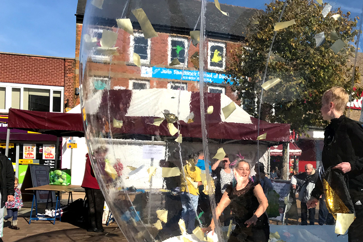 Giant Cash Grabber The Joker Entertainment providing circus entertainment, circus skills, stilt walking, balloon modelling, participation activity's and face painting in the Midlands, Nottinghamshire, Yorkshire, Leicestershire, Lincolnshire, Chesterfield, Wingerworth, Matlock, Derbyshire, Darley Dale, Clowne, Alfreton, Ripley, Wirksworth, Sutton in Ashfield, Kirkby in Ashfield, Nottinghamshire, Leicestershire, Staffordshire, Lincolnshire, South Yorkshire