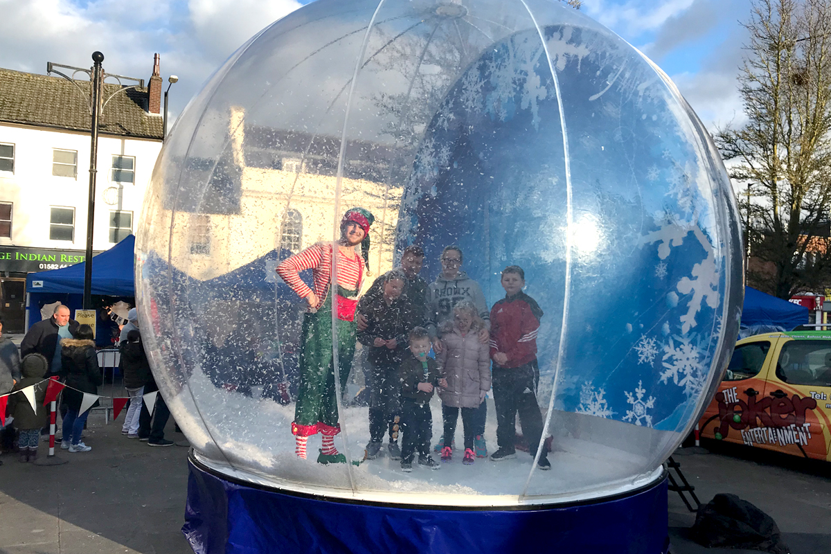 Giant Snow Globe The Joker Entertainment providing circus entertainment, circus skills, stilt walking, balloon modelling, participation activity's and face painting in the Midlands, Nottinghamshire, Yorkshire, Leicestershire, Lincolnshire, Chesterfield, Wingerworth, Matlock, Derbyshire, Darley Dale, Clowne, Alfreton, Ripley, Wirksworth, Sutton in Ashfield, Kirkby in Ashfield, Nottinghamshire, Leicestershire, Staffordshire, Lincolnshire, South Yorkshire