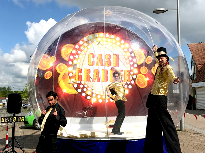 Cash Grabber Giant Beach Globe The Joker Entertainment providing circus entertainment, circus skills, stilt walking, balloon modelling, participation activity's and face painting in the Midlands, Nottinghamshire, Yorkshire, Leicestershire, Lincolnshire, Chesterfield, Wingerworth, Matlock, Derbyshire, Darley Dale, Clowne, Alfreton, Ripley, Wirksworth, Sutton in Ashfield, Kirby in Ashfield, Nottinghamshire, Leicestershire, Staffordshire, Lincolnshire, South Yorkshire