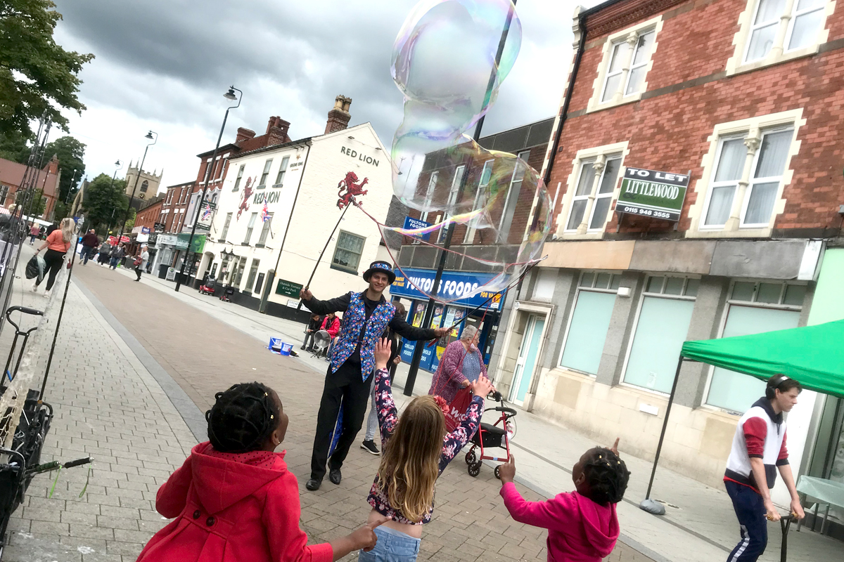 Bubble Entertainer blowing bubbles at your event, some the largest bubble you have ever seen blown by a bubbolagist using the biggest bubble blowers